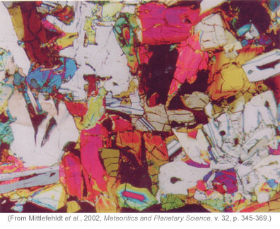 polarized light photomicrograph of D'Orbigny meteorite