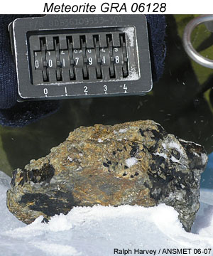 Meteorite GRA 06128 photo taken in Antarctica at time of collection by ANSMET.