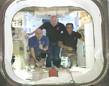 Expedition 31 Flight Engineers (left to right) Don Pettit, Andre Kuipers, and Joe Acaba discuss SpaceX/Dragon's mission during May 26, 2012 news conference from inside the Dragon spacecraft. Photo credit: NASA TV.