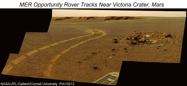 MER Opportunity rover tracks in soil near Victoria Crater, Mars.  Click for more information.