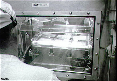 NASA photo S69-40110. July 25, 1969. The first Apollo 11 sample return container in Houston, Texas.